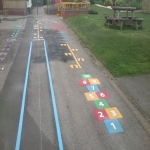 Relining Play Surface Markings in Berrington Green 7